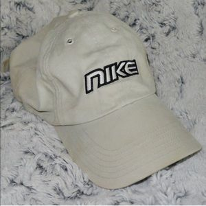Nike spelled out tan colored ball cap